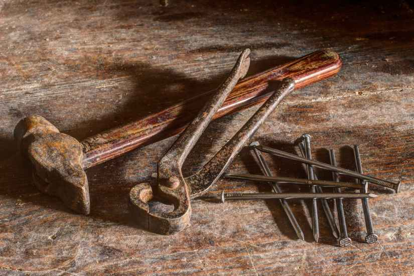 brown hammer near silver nail